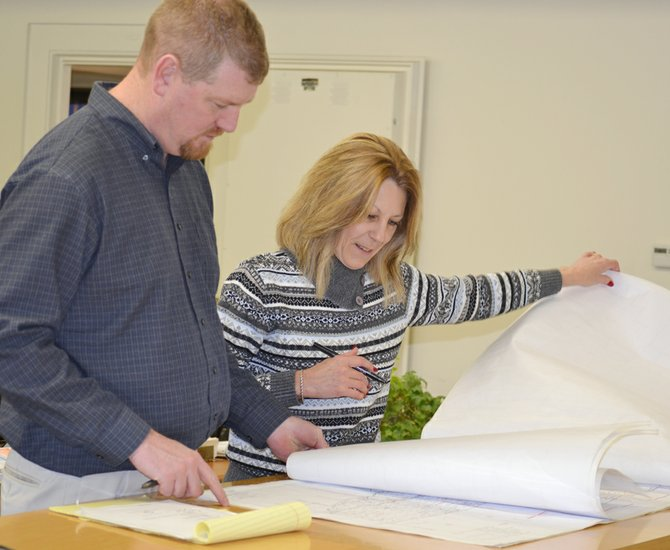 Jody Williams, Roza's bookkeeper/assistant treasurer, reviews documentation with Scott Revell, the irrigation district's manager.