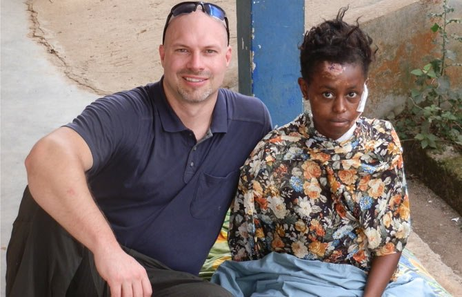 DR. JEFF MATHISEN, a surgeon from The Dalles, is pictured with a patient he operated on in Guinea, Africa who lost a limb in a car crash that killed 18 people. Mathisen has blogged about his three trips to Africa at skopsurgeon.blogspot.com. He and others who are going to Africa April 25 will host a meet-and-greet April 5 from 6 to 9 p.m. at the Riverenza to talk about the Hope Clinic, where he's volunteered in Guinea, and learn about opportunities to serve on medical missions there. 	Contributed photo