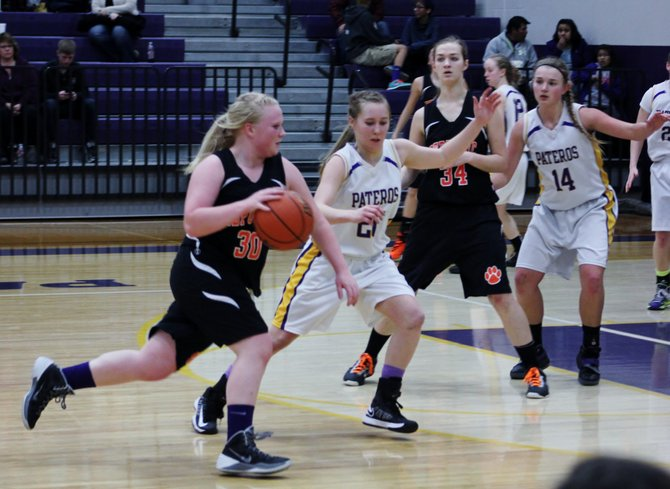 Republic's Savannah Bowe dribbles upcourt past Pateros' Katarina Wilson during second quarter action in a 1B girls regional basketball match-up in Wenatchee.