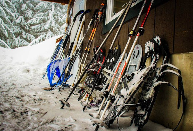 Snowshoes and poles belonging to overnight guests are stored outside the Snow Bowl Hut south of Mount Rainier near Ashford, Wash.