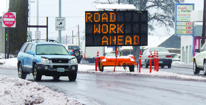 'ROAD WORK ahead' was the general alert for the extensive two-way de-tours due to start Monday on the Heights, where 12th and 13th split. The reader board, along with the snow, went away Monday.