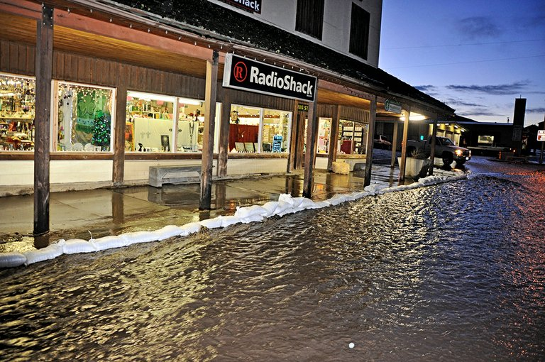 Sandbags line the south side of Cottonwood's Main Street during a Monday evening, March 3, flooding event.