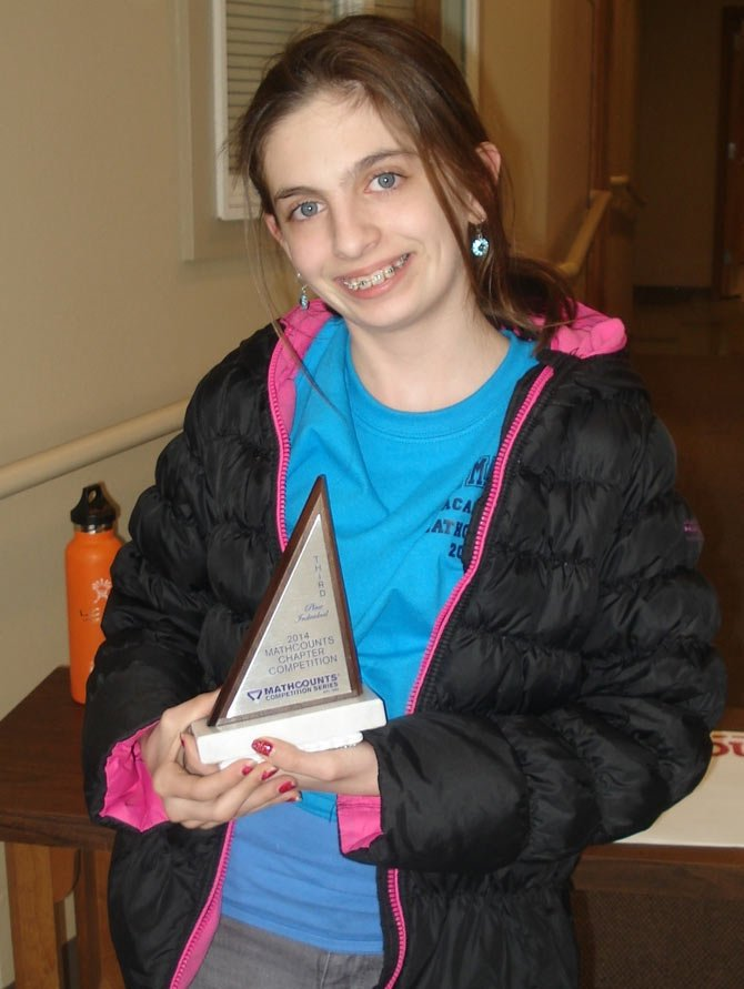 St. Mary's Academy seventh grader Gilly Wolf shows her third-place individual trophy from the recent Central Oregon Chapter Mathcounts competition, held in Redmond Feb. 21.