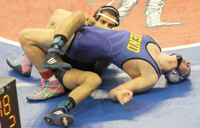 EAGLE INDIAN senior Eric Morales has the upper hand in his 170-pound match against Bend junior Tucker Pies Friday in Portland. Morales ended up scoring a 9-4 decision in this tussle. Morales, a two-time state qualifier, notched two wins and finished one victory short of earning a spot on podium.