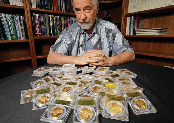 David Hall, co-founder of Professional Coin Grading Service, poses with some of 1,427 Gold-Rush era U.S. gold coins, at his office in Santa Ana, Calif., Tuesday, Feb. 25. A California couple out walking their dog on their property stumbled across the modern-day bonanza: $10 million in rare, mint-condition gold coins buried in the shadow of an old tree.