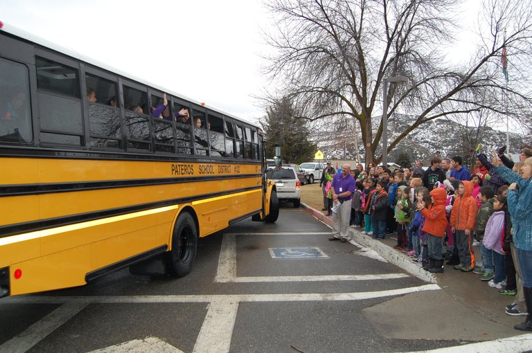 The entire Pateros school community waves goodbye and wishes the Nannies good luck Wednesday morning as they depart for the state 1B tournament in Spokane.