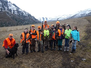 "In partnership with Flying B Ranch in Kamiah, IDFG conservation officers Roy Kinner and George Fischer held the first annual ""Recruitment and Retention"" hunt last Sunday, March 2. ""We took along some of our previous hunter education graduates and parents, as well as some parents with kids on Idaho Youth Hunting Passports that have not completed hunter education yet,"" Fischer said. ""We gave the students a safety class refresher. We then shot sporting clays and did a short hunt introduction class to parents and kids. We bagged a limit of memories and even a few birds. A big 'attaboy' to Flying B Ranch for letting us spend the day with full use of their property and special thanks to The National Wild Turkey Federation and The Lions Club for ammo and several guns."""