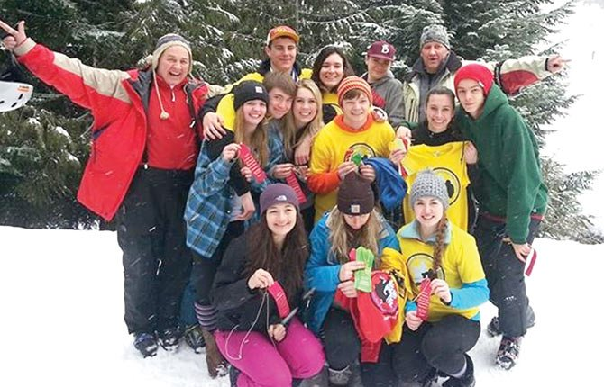 MEMBERS OF The Dalles Ski Team come together for a group shot this past Saturday at Mount Hood Meadows. The boys and girls each finished in second place with the quartet of Eli Holeman, Bailey Cordell, Mark Johnson and Carsen Cordell each finished in the top-6 individually for the strongest finish since the 1990s.