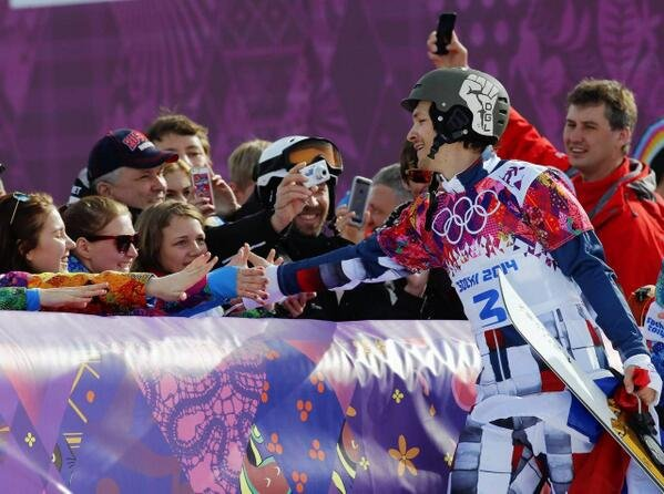 Vic Wild, originally of White Salmon, greets fans after winning the second of two gold medals during the winter Olympics in Sochi, Russia on Feb. 22. The right side of Wild's helmet displays the initials DGL for his longtime friend Dane Gregory Ludwig, who passed away in 2009.