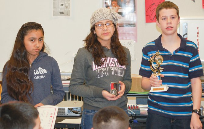 Sunnyside School District middle school science fair winners include (L-R) second-place winner Belen Ruiz, first place winner Karen Villanueva and grand prize winner Michael Condie.