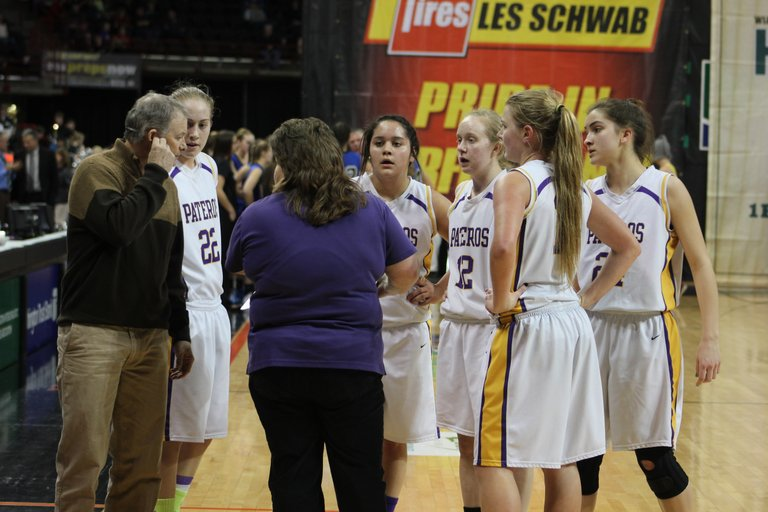 Pateros Coach Sheri Mortimer gives her team a pep talk as the clock ticks down in Thursda's state 1B girls opener against Wilbur-Creston.