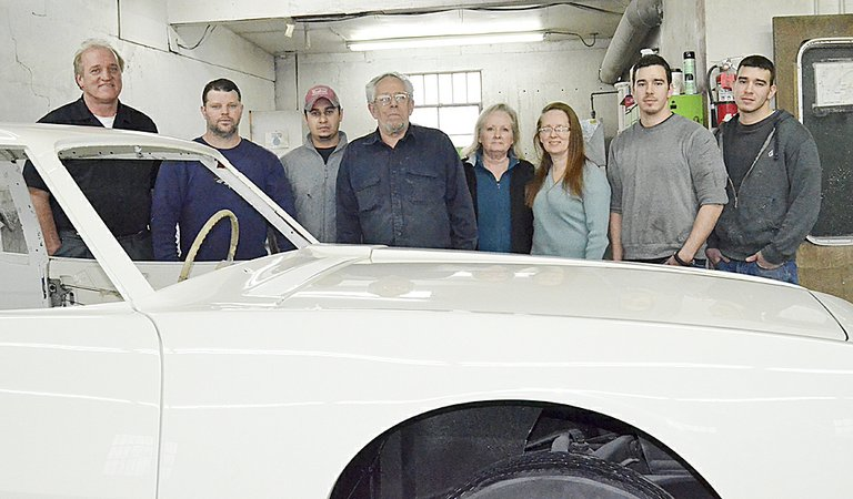 Standing behind the completely restored body of the first-ever produced Studebaker Avanti are the staff of Advanced Collision in Sunnyside. It took numerous volunteer hours to finish the project. Pictured are (L-R) Ron Brest, Jamie Yates, Ray Anciso, Ron and DeAnn Hochhalter, DeLeesa Restucci, Juan and Carlos Donan.