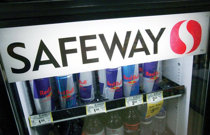 Red Bull and other drinks are on display at a Safeway in San Ramon, Calif. Safeway has agreed to be acquired by an investment group led by Cerberus Capital Management, the owner several supermarket chains. The acquisition of is worth about $7.64 billion in cash, and pending other transactions could top more than $9 billion. The deal, announced late Thursday,March 6, 2014, will bring together Safeway and Albertsons, one of the five chains that Cerberus bought from Supervalu Inc. last year.
