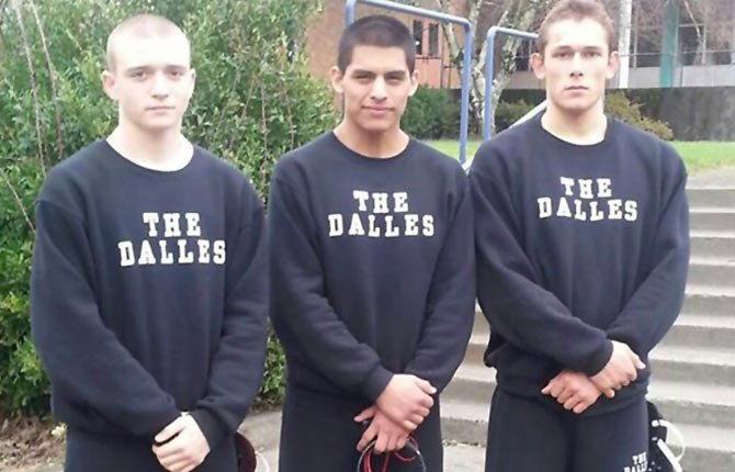 THE DALLES wrestlers (picured from left to right), Mitchell Waters, Eric Morales and Joe Linebarger stand outside Memorial Coliseum last week before competing at state. The trio discussed the state experience and what the future holds.