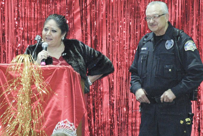 Teri Alvarez-Ziegler, serving as master of ceremonies, called up police officer Chico Rodriquez before the awards ceremony to congratulate him on his upcoming retirement at the end of the month.