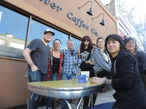 Dog River Coffee crew gathers on the Oak Street sidewalk. From left: Justin Bahr, Lynette Scribner, Nate DeVol, Kimberly Costello, Marissa Essex, Phebe Annis, and Mica Foster. (The café has outside benches, but the table was moved outside just for the photo.)