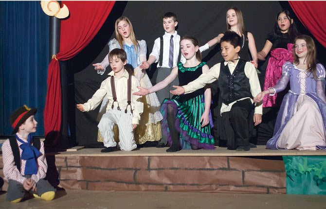 On stage for dress rehearsals of St. Mary's production of Pinocchio are, back row, left to right, Leanord Abbas, third grade; Oscar Powell, fifth grade; Paige Bankhead, fifth grade; and Lola Silva, fourth grade. Front row are Kayden McCavic, third grade; Emily Adams, fifth grade; Simitrio Torres, fourth grade; and Ashlyn Jones, third grade.