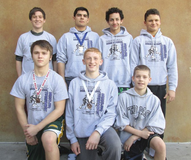 THE Dalles middle School wrestlers (pictured from left to right, front row), Christian Markum, JR Scott and Steven Preston, are joined by teammates (from left), Orville Grout, Michael Parrish, Glenn Brecterfield and Jacob Schacht Monday in The Dalles. These seven wrestlers qualified for state action this weekend. 	  	      Contributed photo