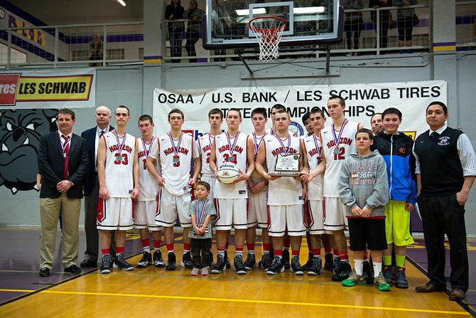 1A state finals Saturday at Baker City came down to Hood River's Horizon Christian School Hawks and Portland's Columbia Christian Knights. The Hawks (above) finished runner-up for a second year in a row after a hard-fought 68-49 loss. Pictured at left (top to bottom) are Mason Bloomster, Matt Totaro and Micah Engel in action in the final game, played in front of a packed house at Baker High School. Although not the result they were hoping for, the Hawks played a tough game against what many said was an unbeatable lineup.