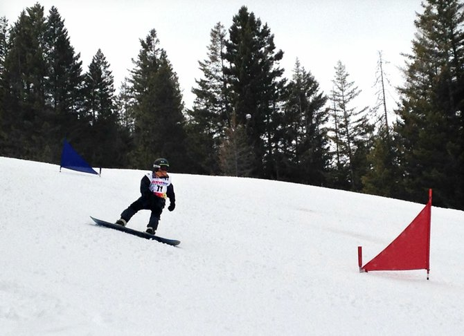 Zyan Shull of Winthrop zooms down a slalom course during the fourth annual Loup Snowboard Races on March 8-9. Shull swept his age division both days.