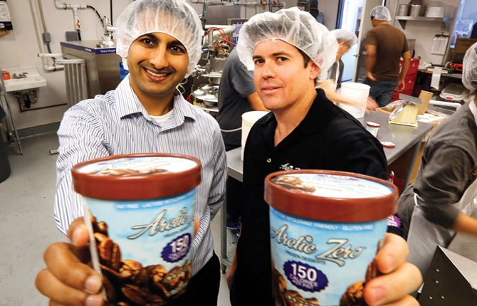 Amit Pandhi, chief executive officer of Arctic Zero, which makes a no-fat, ice cream-like frozen dessert, left, poses with founder Greg Holtman at the company's factory in Pomona, Calif. The makers of Arctic Zero started small, selling their frozen dessert to natural food stores and independent grocers in Southern California. It took years and lots of traveling to get the product on the shelves of major chains like Whole Foods and Wal-Mart.