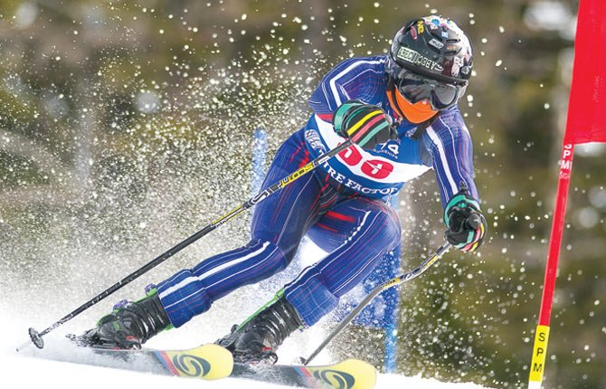 THE DALLES senior Mark Johnson keeps to form on Friday while busting around in giant slalom action Friday on the Middle Fork Run for Oregon Interscholastic Ski Racing Association state skiing action at Mount Hood Meadows. Johnson had a two-run time of one minute and 34.36 seconds.