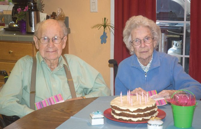 FRIENDS AND FAMILY gathered March 11 at Cascade Senior Care to celebrate the 100th birthday of Viola Wilson, pictured here with her husband, Morris, who is also 100.