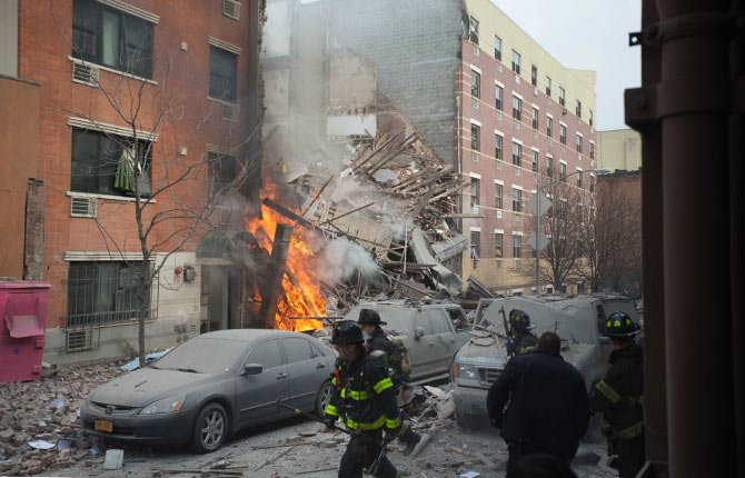 Firefighters work the scene of an explosion that leveled two apartment buildings in the East Harlem neighborhood of New York, Wednesday, March 12, 2014. Con Edison spokesman Bob McGee says a resident from a building adjacent to the two that collapsed reported that he smelled gas inside his apartment, but thought the odor could be coming from outside.