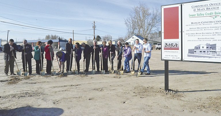 Lower Valley Credit Union staff members and others involved in the construction of a new branch office in Sunnyside break ground on the project yesterday. Wielding golden shovels are (L-R) Wes Edwards, Phil Robillard, Erika Aranda, Rita Gutierrez, Ellane Jepson, Josh Beck, Suzy Fonseca, Cus Arteaga, Kenny Nelson, Lois Lyon, Julie Schilperoort, Carol Newhouse, Caroline Patnode, Ty Hoffard and Colby McGary. A 10,000 square foot building will sit at the corner of Yakima Valley Highway and North Ninth Street in the near future.
