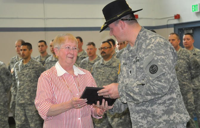 JANET BLOCK of The Dalles receives a certification of appreciation from Oregon National Guard Lt. Col. Brian Dean at a special ceremony Sunday to honor long-term supporters of citizen soldiers.
