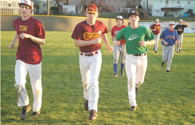 THE DALLES baseball players (pictured from left to right), Austin Wilson, Zach Cantrell, Payton Eaton and Colton Walker finish practice Wednesday at Quinton Street Ballpark with a few running laps. With a roster of eight seniors and two juniors, the Eagle Indians are on a path to defend their 2013 league title.