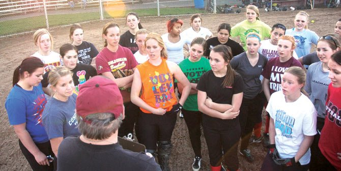 THE DALLES softball coach Steve Garrett forms his team together for a post-practice speech after their session on Wednesday in The Dalles. With a young roster in place, the Tribe will try to use speed, sacrifices and a potent running game to establish a consistent offensive attack in the 2014 campaign.