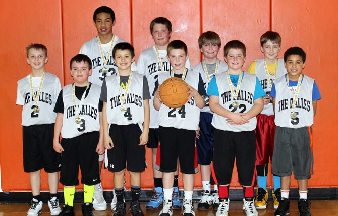 PLAYERS from the 1OU Columbia Gorge Basketball Academy (From Left to right),  Wyatt Townsend, Quincy Townsend, Andrew Savaiinea, Jaxon Pullen, Spencer Taylor, Conner Cummings, Spencer Coburn, Isaac Anthony, Colin Shubert and Styles DeLeon pose for a photo after taking first place at a tournament on March 9. Contributed photo