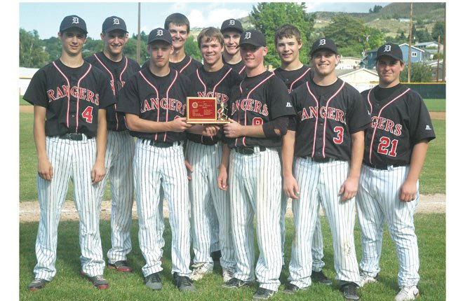 DUFUR baseball players hoist a second place district trophy last season at Quinton Street Ballpark. With all but one player returning and the addition of four new players, the Rangers are rebuilt and reloaded for a chance to compete within the Blue Mountain Conference and the state's elite class.