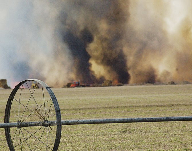 Area firemen struggled to contain a huge blaze that engulfed land from Florence Road near Mabton to Holaday Road on the north side of the Yakima River Sunday morning.  The fire, which reportedly started as a result of a brush fire, was fueled by spring winds and covered more than 100 acres in the Sunnyside State Wildlife and Recreation area.