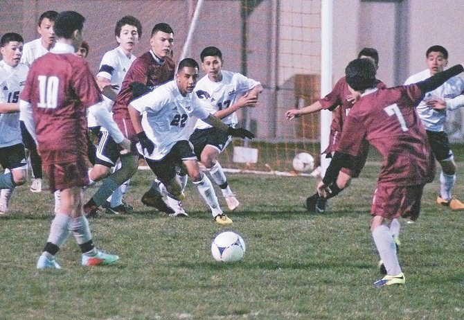 Grandview's Victor Valencia (7) gets set to attempt a kick as Sunnyside's Lupe Granados (22) and other defenders pursue the play. Valencia scored Grandview's lone goal of the game to temporarily tie the match. Looking on at left for Grandview is Israel Aguilar (10).