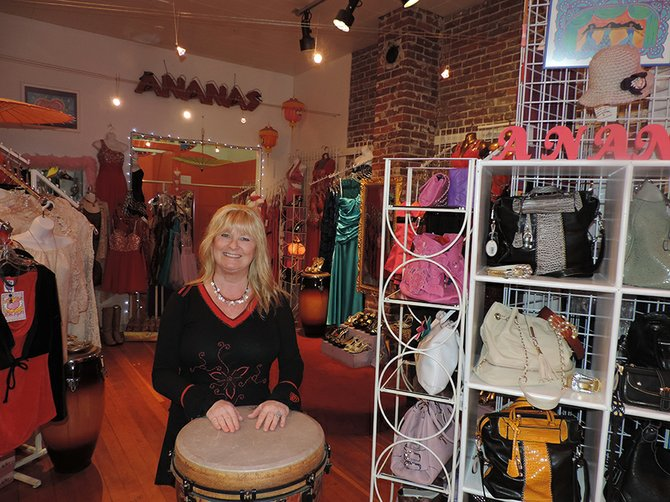Heidi McLennon in her soon-to-be-renovated Ananas Boutique on Oak Street. The McLennons' musical passion is evident in the store's use of drums as product display elements.
