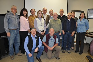 North Central Idaho RAC members recognized March 12 were: back (L to R) Don Ebert, Randy Doman, Steve Didier, Jim Rehder and Lisa Canaday (RAC Coordinator); middle (L to R):  David Bodine, Laura Smith (RAC Designated Federal Official), Linda Hinds (RAC Budget Officer), Kent Henderson (RAC Chairman), Bob Hafer, Chris St. Germaine; front (L to R);  Forest Supervisor Rick Brazell and Gary Lane. Not pictured: Brett Bennett, Bob Abbott, Susie Borowicz and Emmit Taylor.