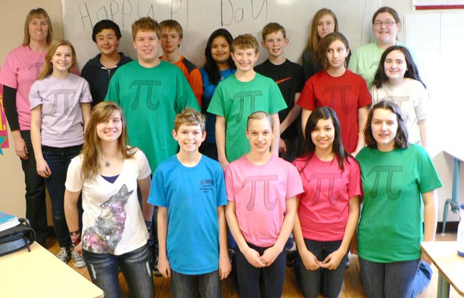 St. Mary's Academy eighth graders celebrate Pi Day on March 14 wearing T-shirts sporting the symbol for the mathmatical figure. Teachers said students also made time to eat delicious pies and play games to further mark the occassion. Contributed photo