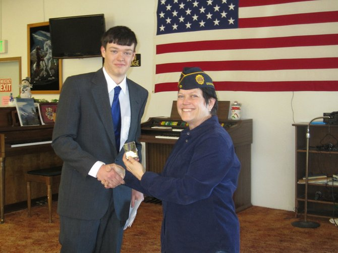 Contributed photo Joey Higgins is seen here receiving the oratorical contest award from Grangeville American Legion No. Post 37 Commander Virginia Cash.