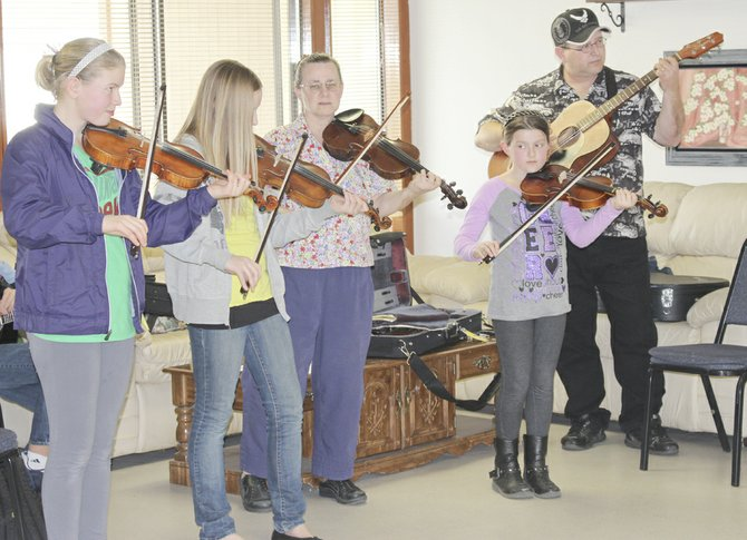 The Gone Fiddling group of Yakima introduced a group of young fiddlers to the Sunnyside senior citizen community gathered at the Sunnyside Senior Citizen Center last Saturday afternoon. Pictured are (L-R) Georgia Strom, Alison Dowd, Cheryl Hall, Alexis Barbee and Chuck Adams, all of Yakima.