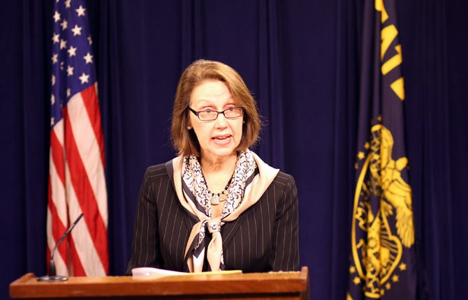 Oregon Attorney General Ellen Rosenblum reads a statement at the State Capitol in Salem Feb. 20, modifying the state's legal position in federal lawsuits that challenge Oregon's ban on same-sex marriage.
