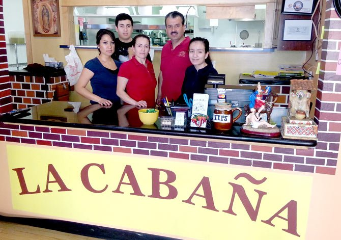 A FAMILY-OWNED operation, La Cabaña is now under the ownership the Gamez family, but has retained longtime employee Tania Marines, left, as restaurant management. The Gamez family includes, from left, Jesus, Angelica, Luis and Brianna.