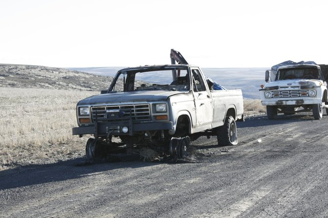 The Douglas County Sheriff's Office is investigating the burning of a pickup truck and utility trailer parked near the intersection of Olson Road and Road A S.W.