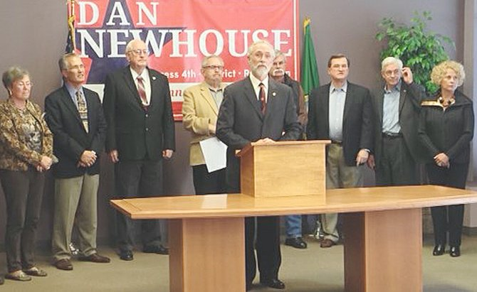 Elected officials endorsing Dan Newhouse (standing at podium) for Congress during an event in Yakima yesterday are (L-R) Yakima Councilwoman Maureen Adkison, Yakima County Commissioner Kevin Bouchey Sen. Jim Honeyford, Rep. Norm Johnson, Yakima Councilman Tom Dittmar, Rep. Bruce Chandler, Yakima Councilwoman Kathy Coffey and Sen. Curtis King.