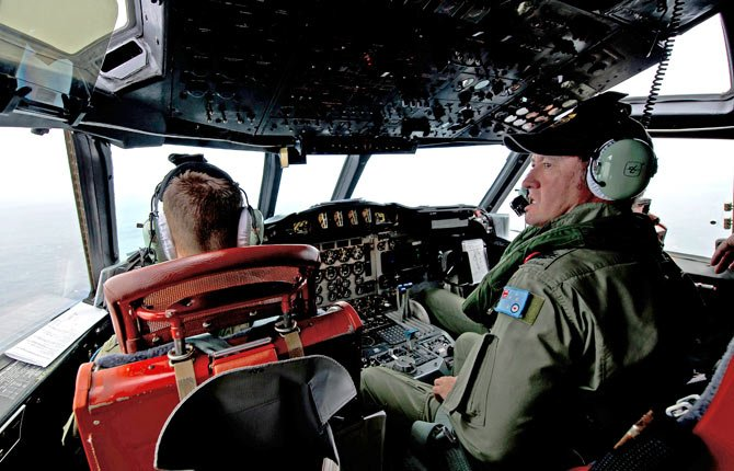 Royal Australian Air Force Flight Engineer, Warrant Officer Ron Day from 10 Squadron, on board an AP-3C Orion over the Southern Indian Ocean off the Western Australian coast during a search operation for the missing Malaysian Airlines flight MH370 on March 19.