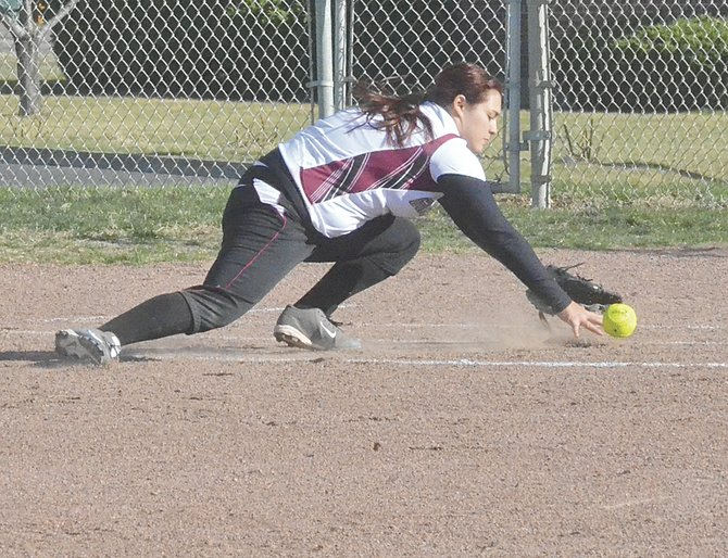 Grandview's Maritza Galvan attempts to scoop up the ball at third.