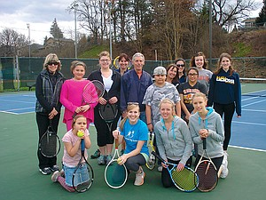 Bigs and littles, along with HRVHS tennis team volunteers, gather following the March 16 tennis clinic at the renovated Hood River Community/Tsuruta tennis courts on May Street.