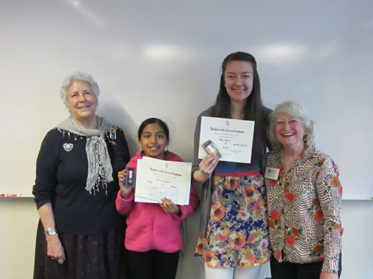 DAR essay contest winners Ariana Acevedo and Abby Walker with Celilo Chapter Regent Joni Walker, left, and essay contest chair Nancy Slagle, right.