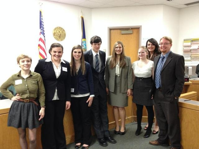 Pictured is Grangeville High School's mock trial team 2014 (L-R) Heather Nelson, Lily Willig, Carlee Lothspeich, Joseph Higgins, Lila Musegades, Katherine Craig, Lauren Goldman and Attorney Adam Green.